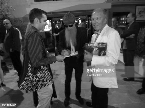 Billy Gibbons of ZZ Top signs an autograph with publicist Bob Merlis by his side at the Sunset Marquis Hotel in Los Angeles California on August 11...