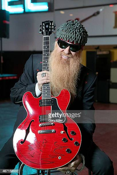 Billy Gibbons signs a Gibson Guitar to give as a gift to Roky Erickson at 'Roky Erickson's Ice Cream Social' during the South By Southwest Music...