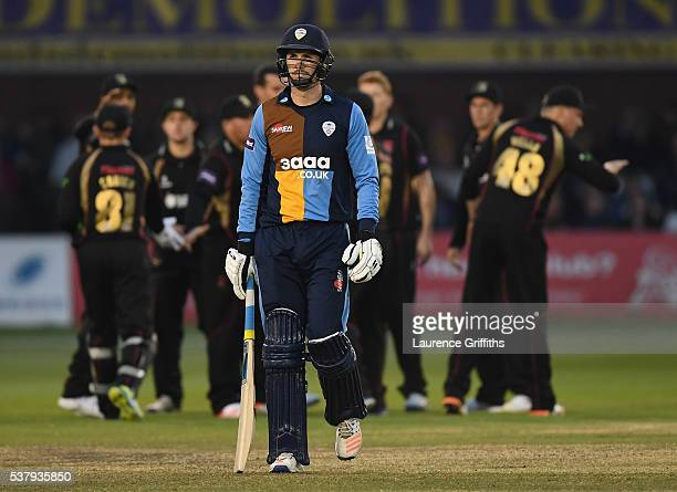 Billy Godleman of Derbyshire walks to the pavilion after being caught for 2 runs off te bowling of Clint McKay of Leicestershire during the NatWest...