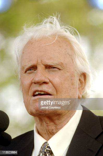 Billy Graham delivers his Farewell Message to a crowd of thousands on Day 3 of his final crusade at the Flushing Meadows Park in New York City New...
