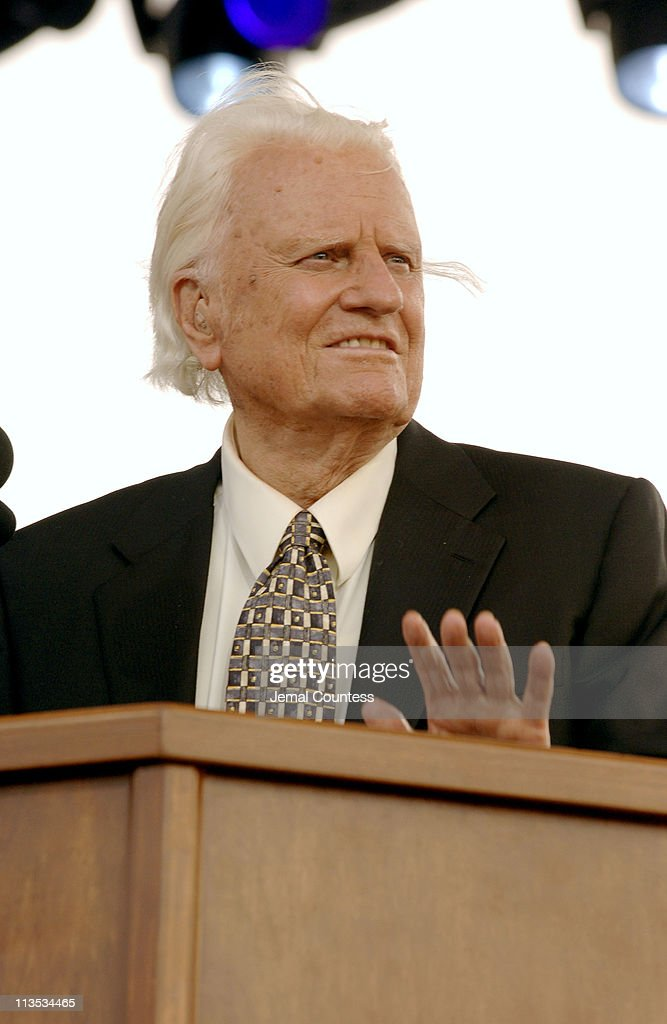 Billy Graham delivers his Farewell Message to a crowd of thousands on day 3 of his final crusade at the Flushing Meadows Park in New York City