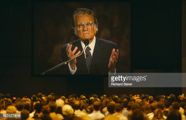Billy Graham preaches with sincere confidently open hands to British Christians during Mission 89 a series of evangelical revival rallies in London...