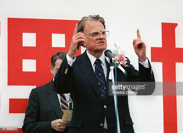 Billy Graham the American evangelist preaches 07 November 1990 on a podium in Hong Kong during his tour to Asia and the Pacific region Graham...