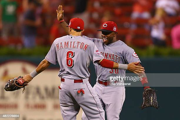 Billy Hamilton and Jason Bourgeois of the Cincinnati Reds celebrate after beating the St Louis Cardinals at Busch Stadium on July 28 2015 in St Louis...