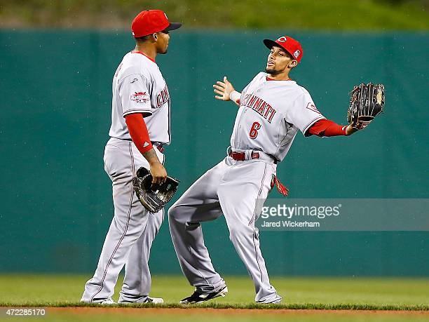 Billy Hamilton and Marlon Byrd celebrate their win against the Pittsurgh Pirates of the Cincinnati Reds during the game at PNC Park on May 5 2015 in...