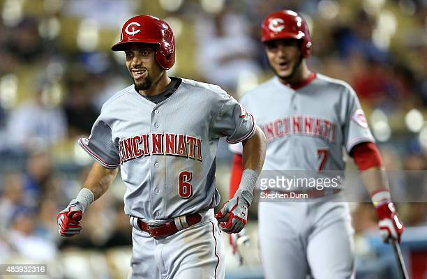 Billy Hamilton and on deck batter Eugenio Suarez of the Cincinnati Reds smile as Hiamilton returns to the dugout after hitting a solo home run in the...