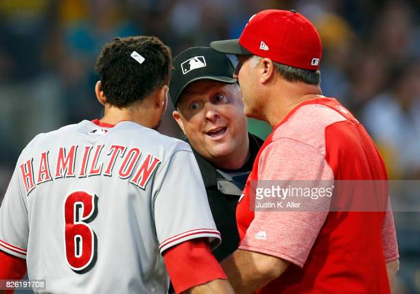 Billy Hamilton of the Cincinnati Reds argues with home plate umpire Todd Tichenor against the Pittsburgh Pirates at PNC Park on August 3 2017 in...