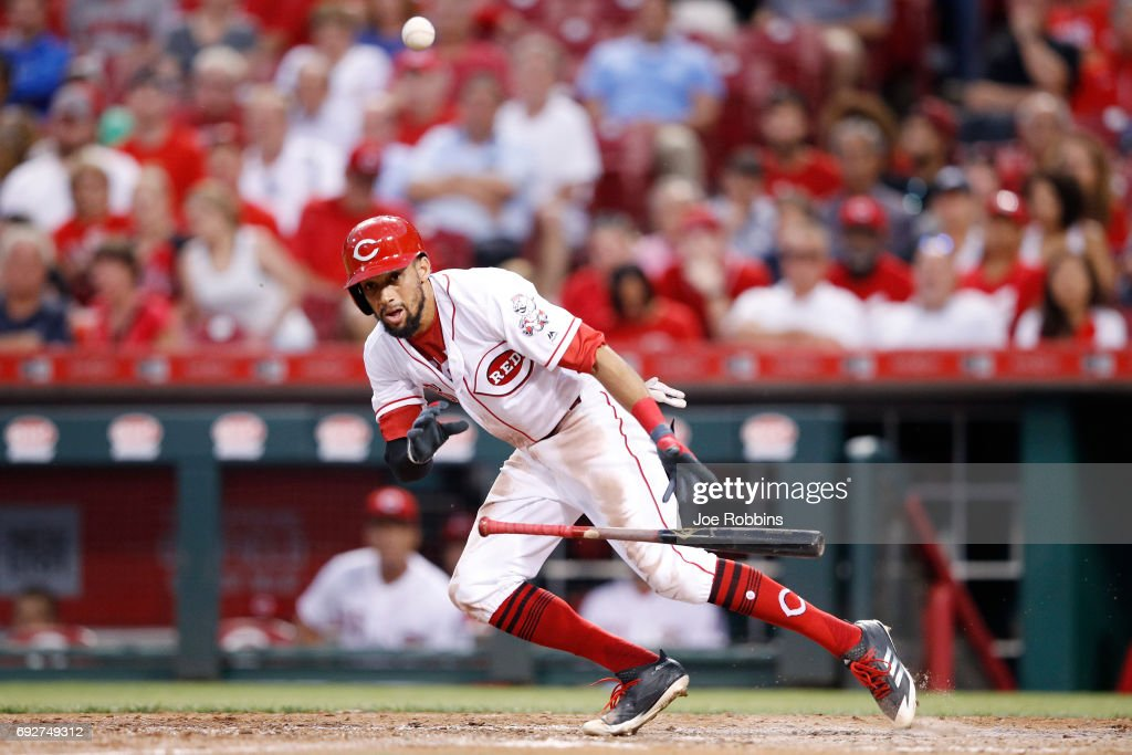Billy Hamilton #6 of the Cincinnati Reds bunts for a single in the seventh inning of a game against the St. Louis Cardinals at Great American Ball Park on June 5, 2017 in Cincinnati, Ohio. The Reds defeated the Cardinals 4-2.