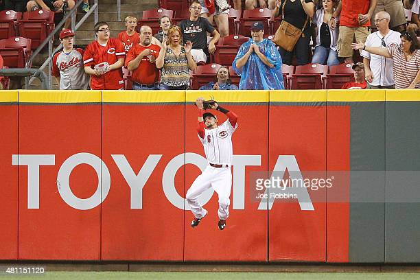 Billy Hamilton of the Cincinnati Reds catches a fly ball near the center field wall in the fourth inning against the Cleveland Indians at Great...