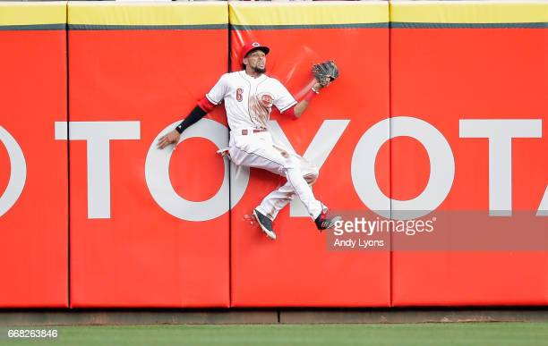 Billy Hamilton of the Cincinnati Reds catches the ball hit by Domingo Santana of the Milwaukee Brewers in the first inning at Great American Ball...