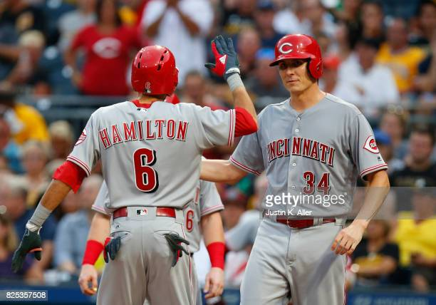 Billy Hamilton of the Cincinnati Reds celebrates with Homer Bailey of the Cincinnati Reds after hitting a three run home run in the second inning...