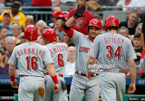 Billy Hamilton of the Cincinnati Reds celebrates with Joey Votto of the Cincinnati Reds after hitting a three run home run in the second inning...