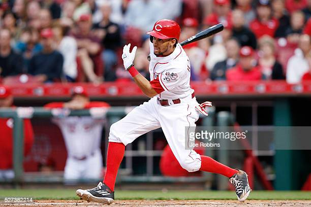 Billy Hamilton of the Cincinnati Reds drives in a run with a double against the San Francisco Giants in the third inning of the game at Great...