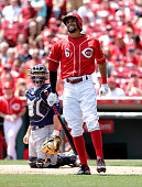 Billy Hamilton of the Cincinnati Reds grimaces after being hit by a pitch in the first inning against the Seattle Mariners at Great American Ball...