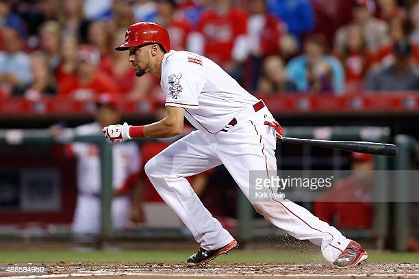 Billy Hamilton of the Cincinnati Reds hits the ball during the game against the St Louis Cardinals at Great American Ball Park on September 11 2015...