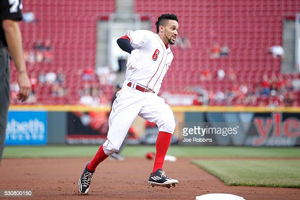 Billy Hamilton of the Cincinnati Reds holds at third base after a triple against the Pittsburgh Pirates in the first inning of the game at Great...