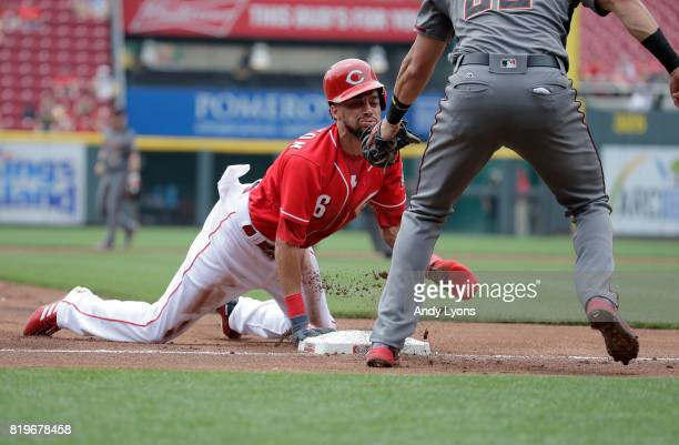 Billy Hamilton of the Cincinnati Reds is tagged out at third base as he was attempting to steal a base in the first inning against the Arizona...