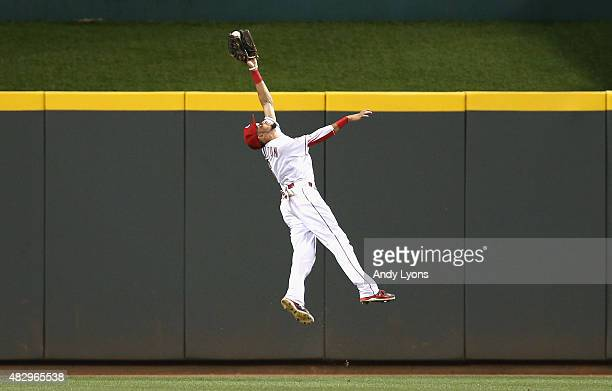 Billy Hamilton of the Cincinnati Reds leaps to catch the ball hit by Jason Heyward of the St Louis Cardinals in the 8th inning at Great American Ball...
