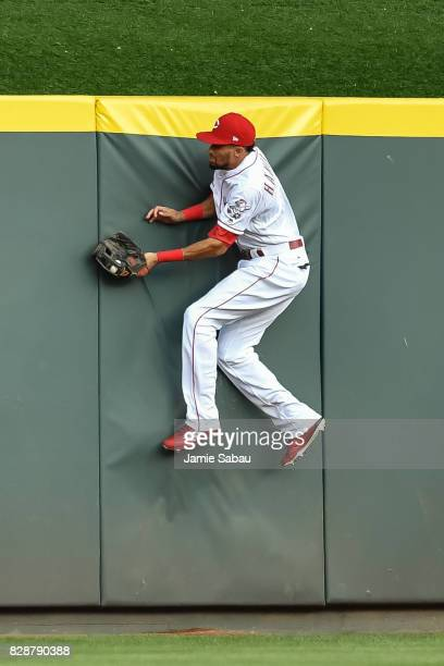 Billy Hamilton of the Cincinnati Reds makes a catch against the outfield wall against the San Diego Padres at Great American Ball Park on August 8...