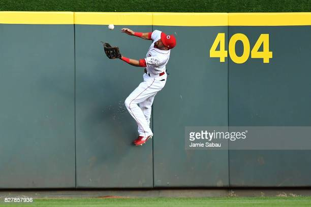 Billy Hamilton of the Cincinnati Reds makes a catch off the center field wall in the third inning against the San Diego Padres at Great American Ball...