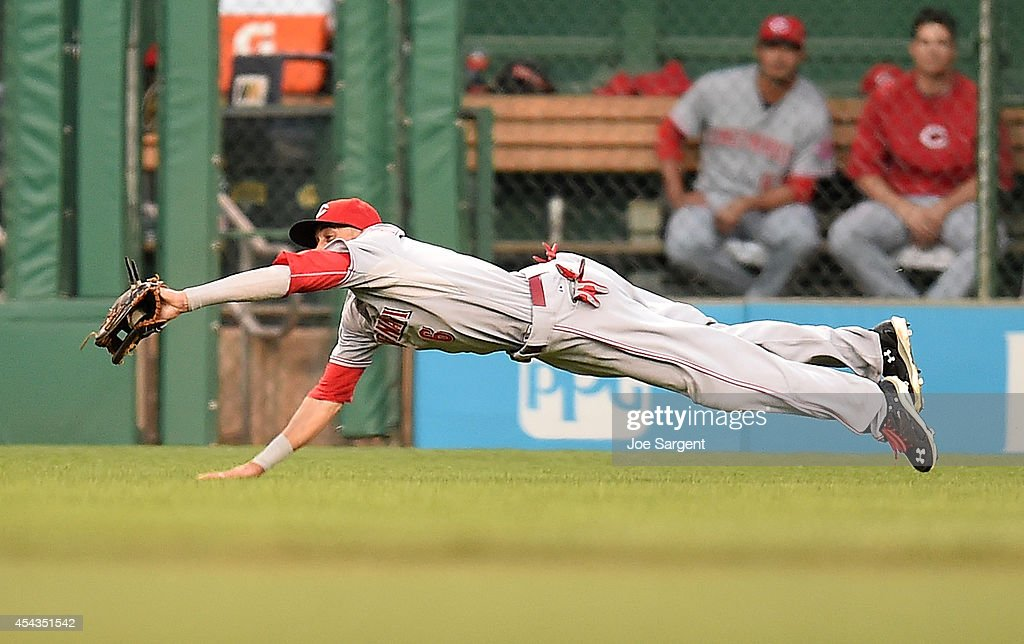 Billy Hamilton of the Cincinnati Reds makes a diving catch during the second inning against the Pittsburgh Pirates on August 29 2014 at PNC Park in...