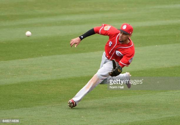 Billy Hamilton of the Cincinnati Reds makes a diving catch during the fifth inning against the Arizona Diamondbacks at Salt River Fields at Talking...