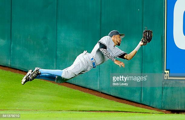 Billy Hamilton of the Cincinnati Reds makes a diving catch in centerfield on a fly ball by Jose Altuve of the Houston Astros in the fifth inning at...