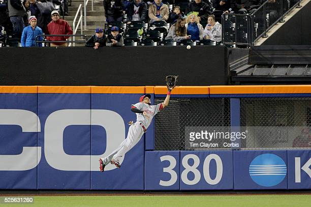 Billy Hamilton of the Cincinnati Reds makes a spectacular diving catch at center field to rob Kevin Plawecki of the New York Mets of a hit in the...