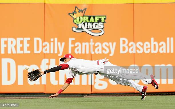 Billy Hamilton of the Cincinnati Reds reaches to catch the ball during the game against the Detroit Tigers at Great American Ball Park on June 17...