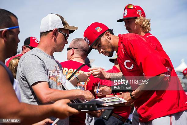 Billy Hamilton of the Cincinnati Reds signs autographs before a spring training game against the Cleveland Indians at Goodyear Ballpark on March 1...