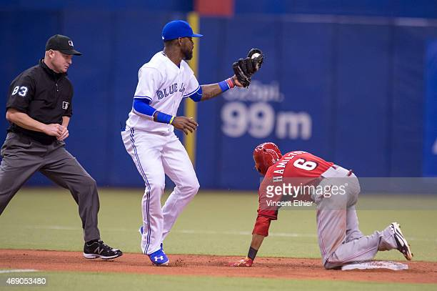 Billy Hamilton of the Cincinnati Reds slides safely into second base during the exhibition game against the Toronto Blue Jays at Olympic Stadium on...