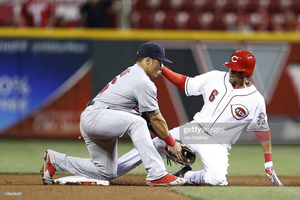 Billy Hamilton #6 of the Cincinnati Reds steals second base ahead of the throw to Kolten Wong #16 of the St. Louis Cardinals in the 14th inning of the game at Great American Ball Park on September 4, 2013 in Cincinnati, Ohio. The Cardinals won 5-4 in 16 innings.