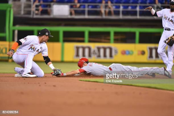 Billy Hamilton of the Cincinnati Reds steals second base during the first inning against the Miami Marlins at Marlins Park on July 28 2017 in Miami...