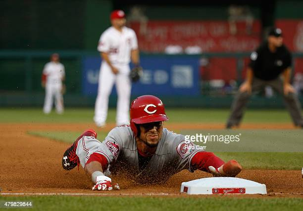 Billy Hamilton of the Cincinnati Reds steals third base against the Washington Nationals in the fifth inning at Nationals Park on July 7 2015 in...