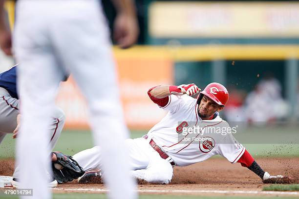 Billy Hamilton of the Cincinnati Reds steals third base in the second inning against the Minnesota Twins at Great American Ball Park on June 29 2015...