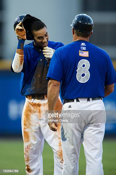 Billy Hamilton of the Pensacola Blue Wahoos smiles as manager Jim Riggleman congratulates him after breaking the minor league record of stolen bases...