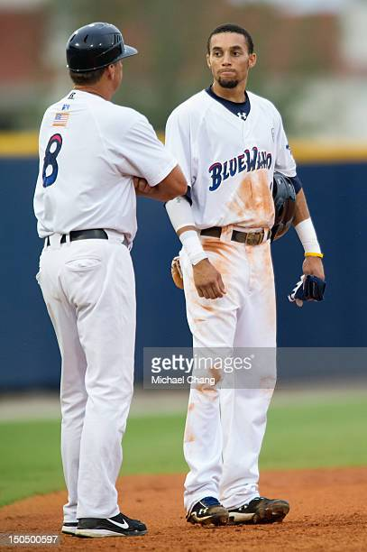 Billy Hamilton of the Pensacola Blue Wahoos talks with team manager Jim Riggleman while playing against the Montgomery Biscuits at Community Maritime...