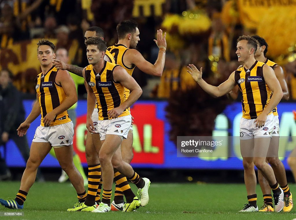 Billy Hartung of the Hawks celebrates with team mates after scoring a goal during the round seven AFL match between the Richmond Tigers and the Hawthorn Hawks at Melbourne Cricket Ground on May 6, 2016 in Melbourne, Australia.