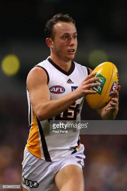 Billy Hartung of the Hawks looks to pass the ball during the round 18 AFL match between the Fremantle Dockers and the Hawthorn Hawks at Domain...