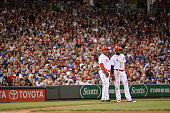 Billy Hatcher of the Cincinnati Reds and Brandon Phillips of the Cincinnati Reds wait for the next pitch at third base against the Chicago Cubs at...