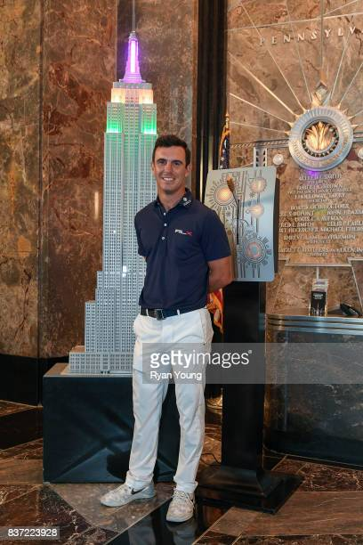 Billy Horschel flips the switch to light up the Empire State Building in FedEx colors during a preview media tour for THE NORTHERN TRUST on August 22...