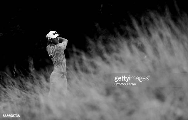 Billy Horschel hits a tee shot on the 13th hole during the first round of the Wyndham Championship at Sedgefield Country Club on August 17 2017 in...