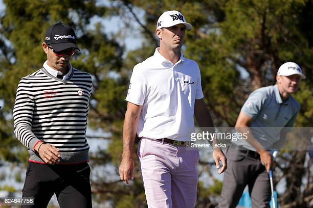 Billy Horschel of the United States and Camilo Villegas of Colombia walk off the 7th tee box during the final round of the RSM Classic at Sea Island...
