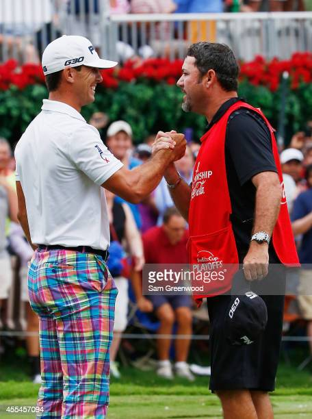 Billy Horschel of the United States celebrates with his caddie Micah Fugitt on the 18th green after winning both the TOUR Championship by CocaCola...