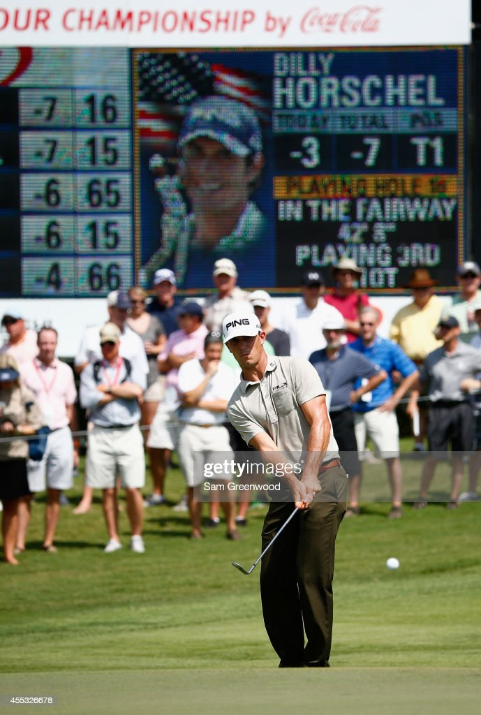 <a gi-track='captionPersonalityLinkClicked' href=/galleries/search?phrase=Billy+Horschel&family=editorial&specificpeople=565390 ng-click='$event.stopPropagation()'>Billy Horschel</a> of the United States hits a pitch shot on the 16th hole during the second round of the TOUR Championship by Coca-Cola at the East Lake Golf Club on September 12, 2014 in Atlanta, Georgia.