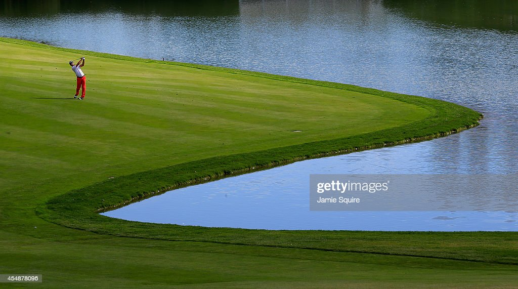 Billy Horschel of the United States hits his approach shot on the 18th hole during the final round of the BMW Championship at the Cherry Hills...