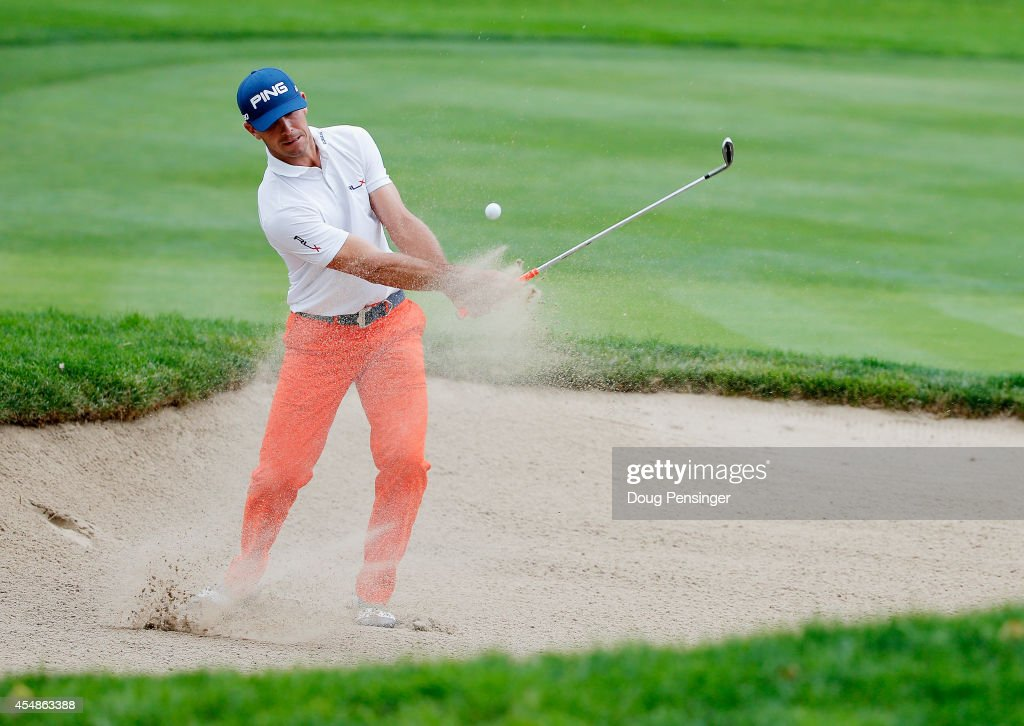 Billy Horschel of the United States plays a bunker shot on the sixth hole during the final round of the BMW Championship at the Cherry Hills Country...