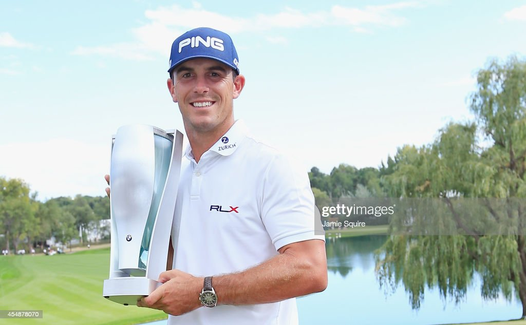 Billy Horschel of the United States poses with the winner's trophy after his twostroke victory at the BMW Championship at the Cherry Hills Country...