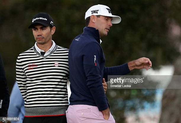 Billy Horschel of the United States reacts as Camilo Villegas of Colombia consoles him after missing his putt to get knocked out of first playoff...