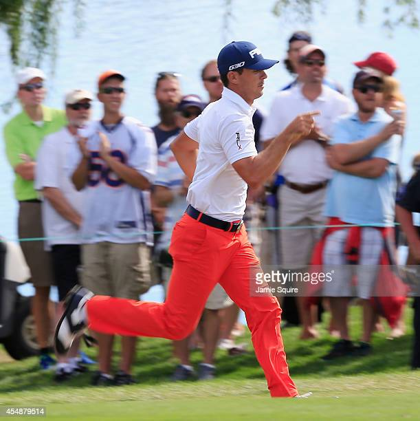 Billy Horschel of the United States runs to use the restroom near the 18th fairway during the final round of the BMW Championship at the Cherry Hills...